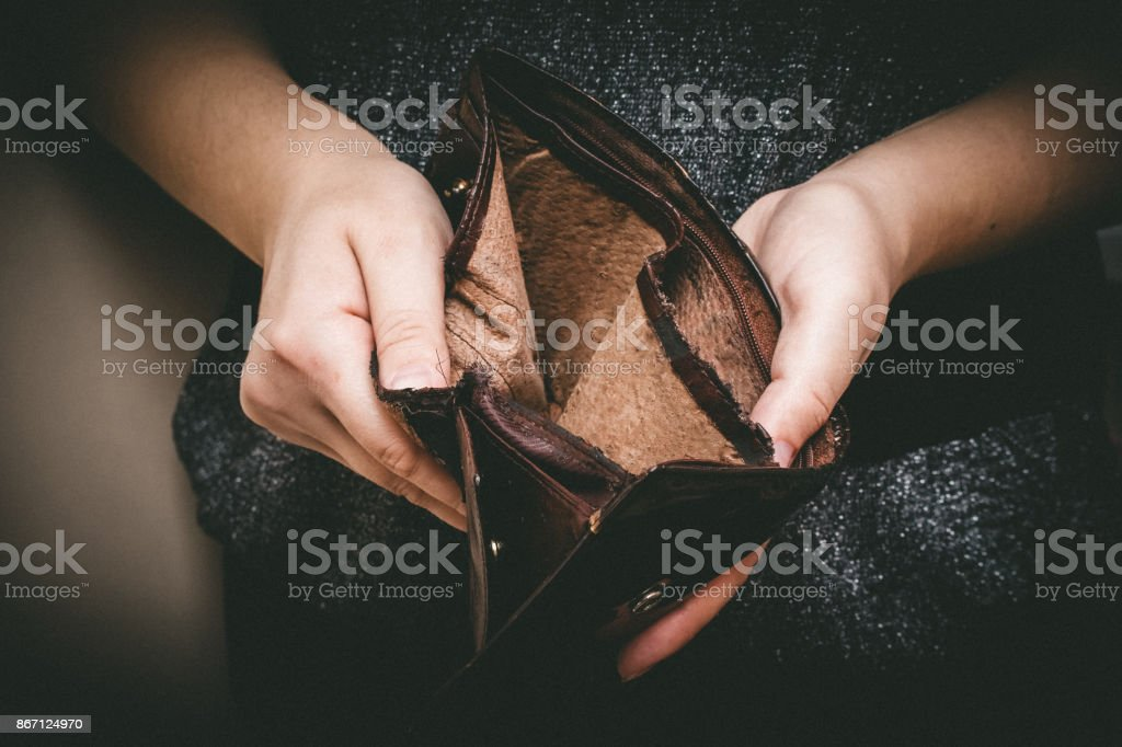 Old empty wallet in the hands .Vintage empty purse in hands of women . Poverty concept, Retirement. Special toning stock photo