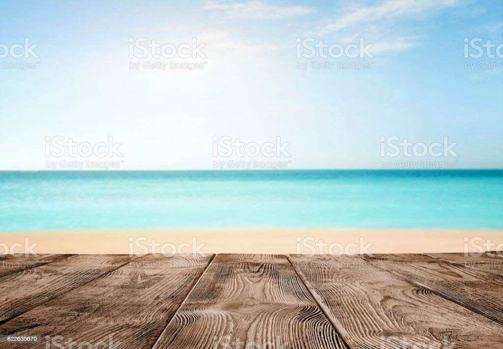Old empty wooden pier over the turquoise ocean stock photo