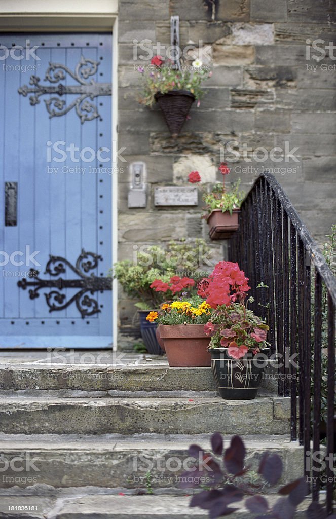 Old English architecture in stone - house entrance with steps royalty-free stock photo
