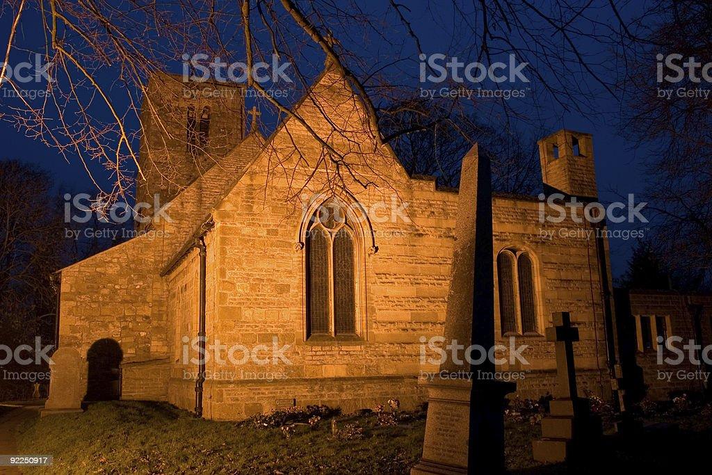 Old English church at dusk stock photo