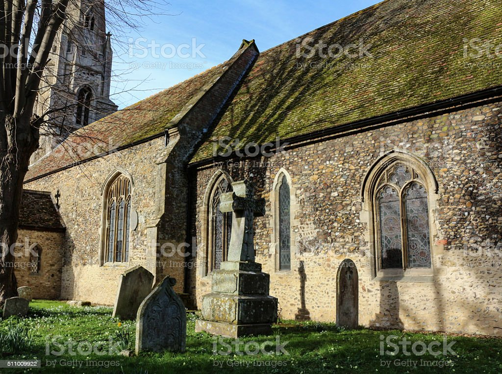 Old English Church With Casting Shadows stock photo