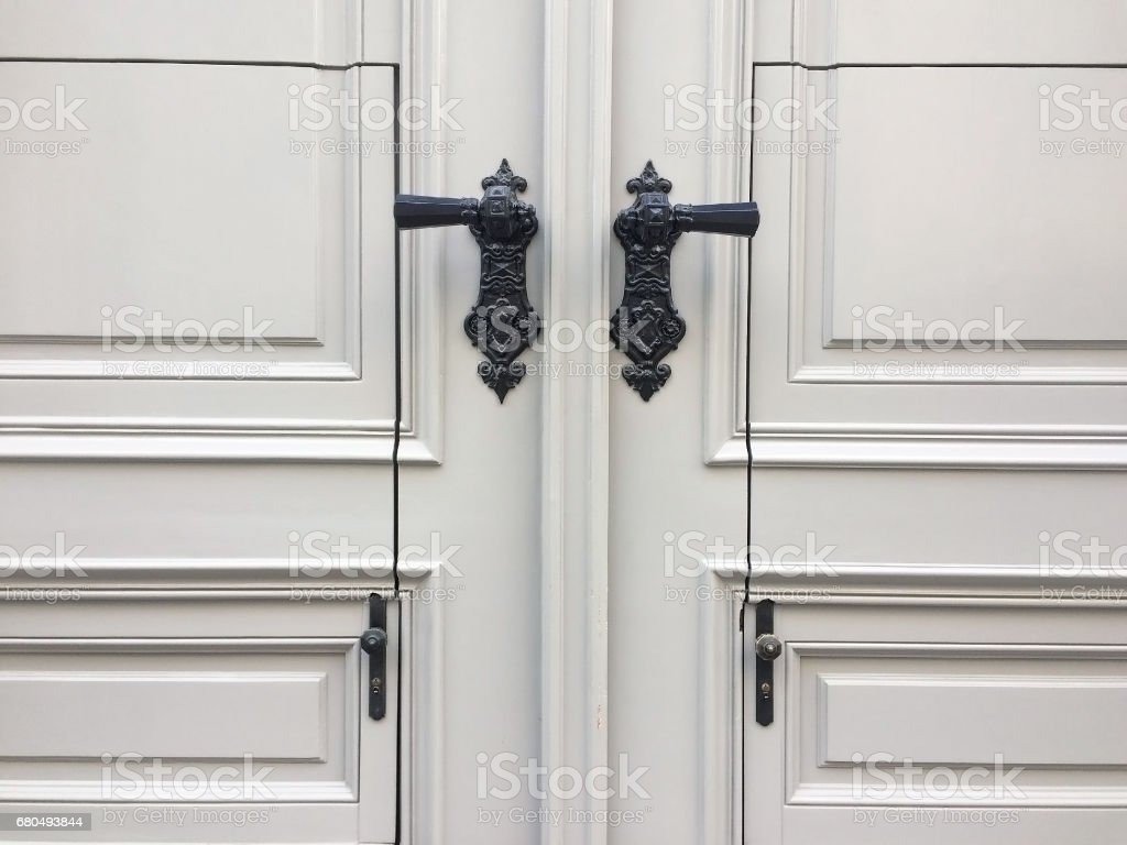 Vintage white doors with black iron handles