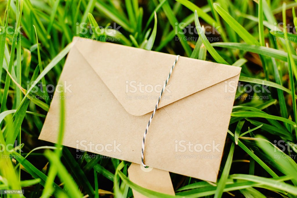 Old envelope on the lawn with room to place text stock photo