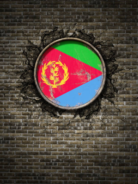 old eritrea flag in brick wall - eritrea stock photos and pictures