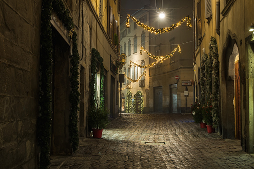 Old European narrow empty street of medieval town