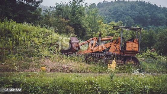 The old excavator is left out