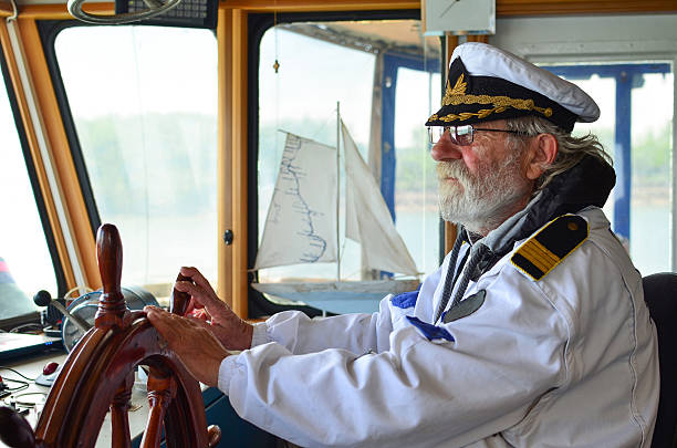 Old experienced captain in navigation cabine - Photo