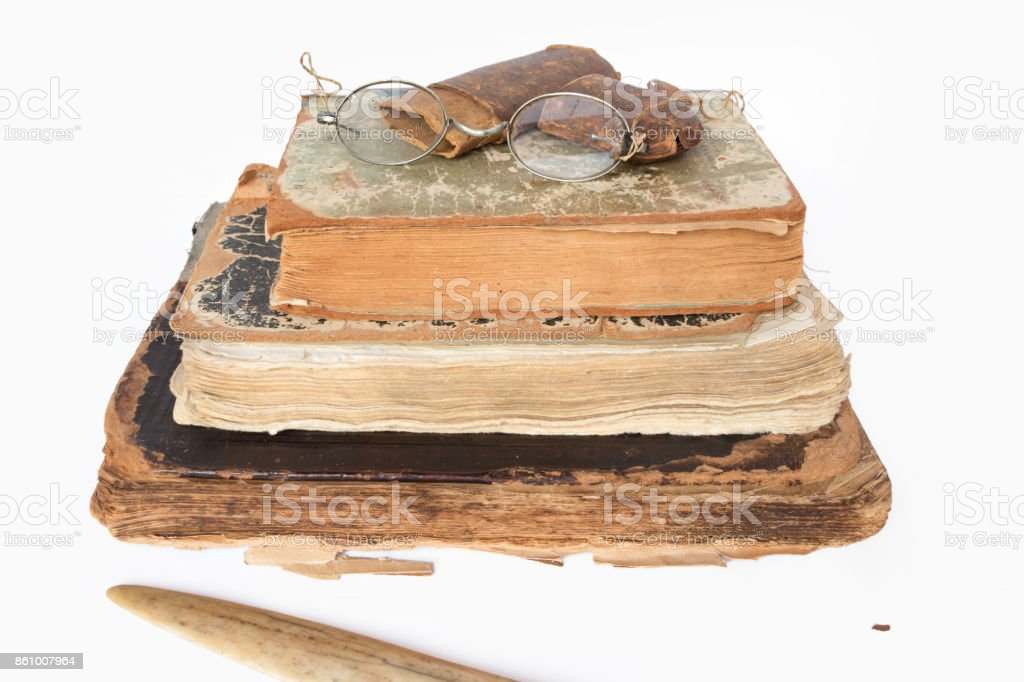 Old eyeglasses and paper case on vintage books stock photo