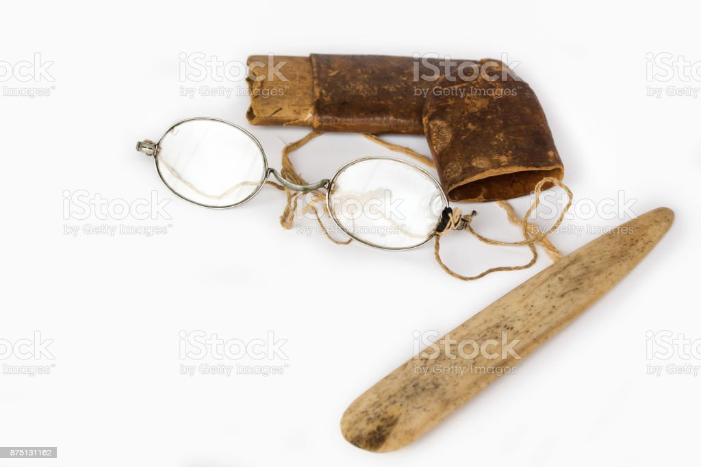Old eyeglasses with paper case and ivory tab stock photo