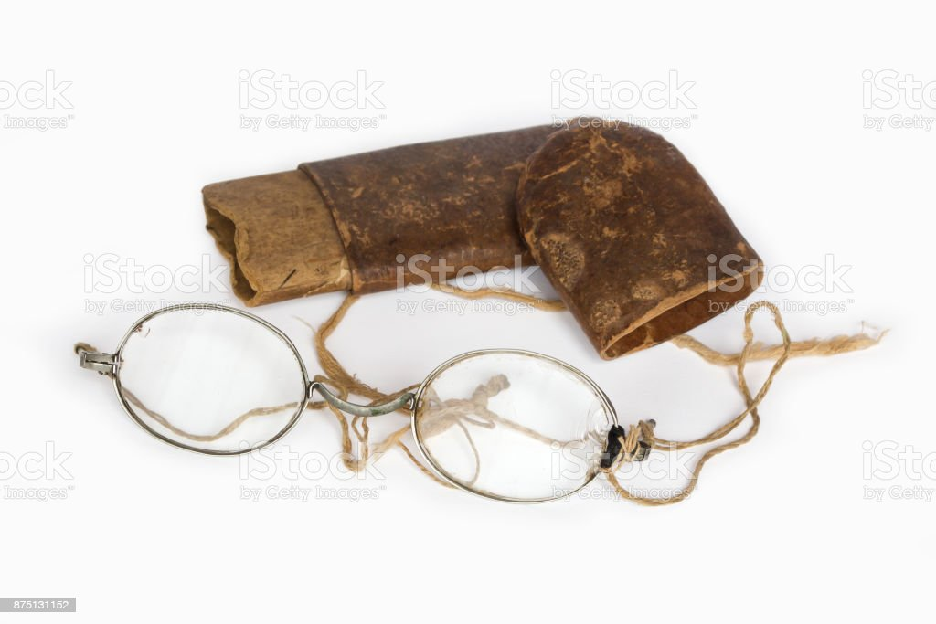 Old eyeglasses with paper case on white background stock photo