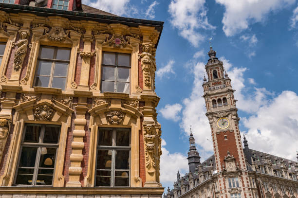 Old facade ans Belfry of the Chambre de Commerce. Lille, France - 15 June 2018: Old facade ans Belfry of the Chambre de Commerce. hauts de france stock pictures, royalty-free photos & images