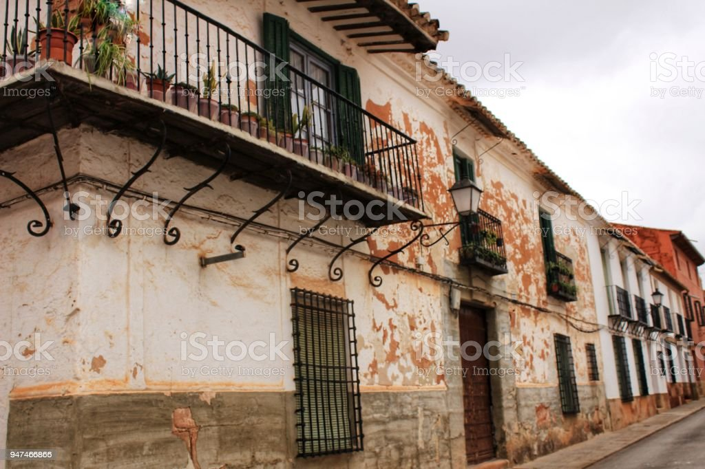 Old facades, balconies and vintage lanterns in Villanueva de los Infantes, Spain stock photo