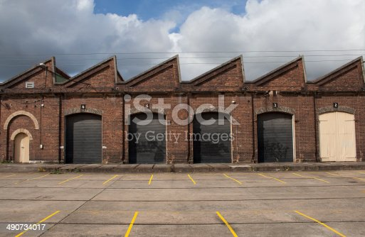 Old traditional factory building main facade with big gates