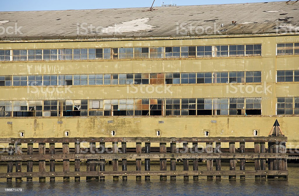 Old factory building on river being demolished stock photo