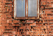 Old factory window with broken glass