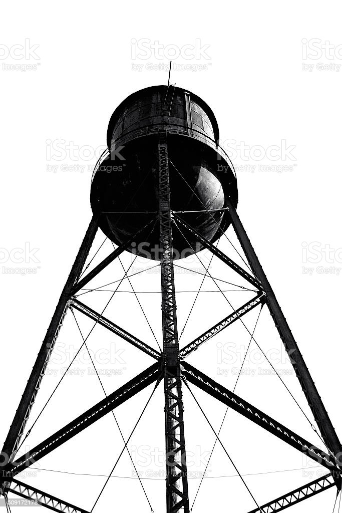 Old factory with water tower standing above stock photo