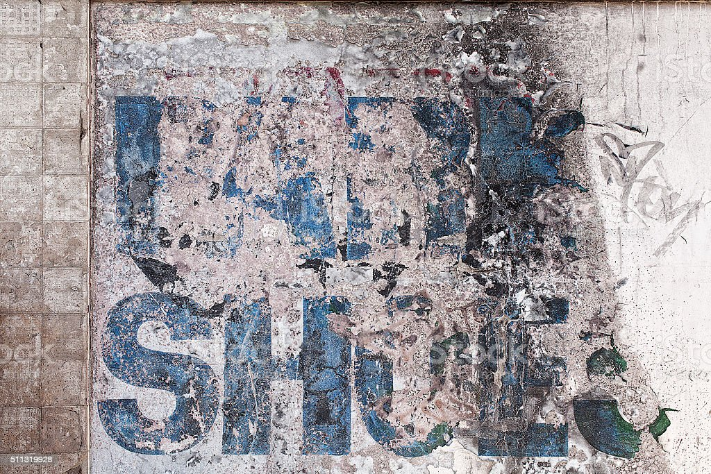 Old faded sign on a wall stock photo