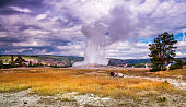 Old Faithful erupts during the winter in Yellowstone National Park