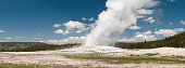 Panorama of Old Faithful Geyser in Yellowstone National Park.