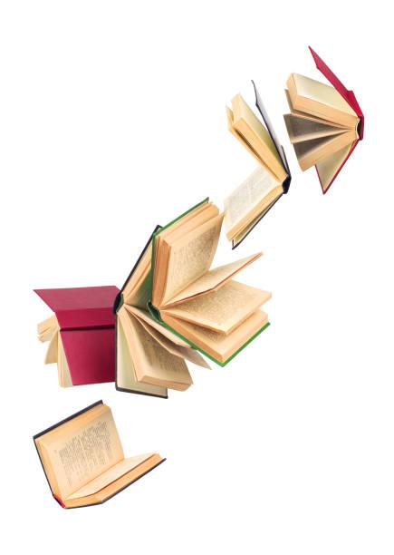 eski düşen kitaplar - kitap stok fotoğraflar ve resimler