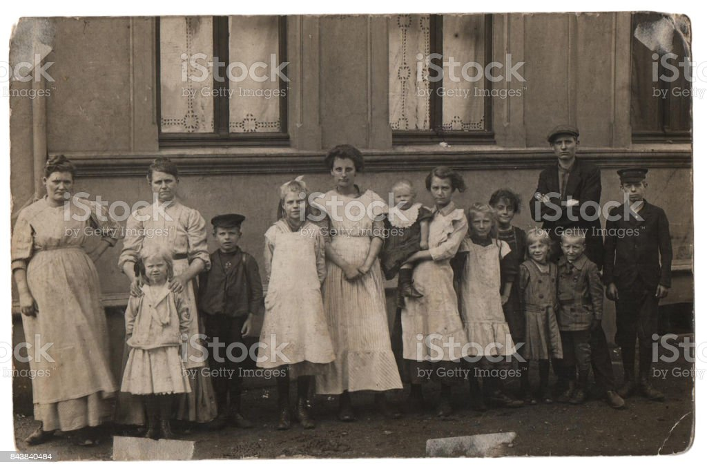 Old family photo, parents with eleven children stock photo