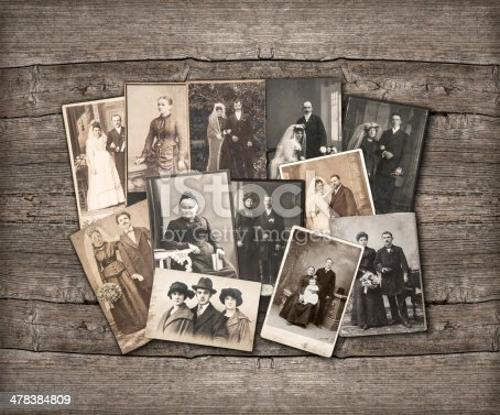 istock Old family photos laid out on wooden background 478384809