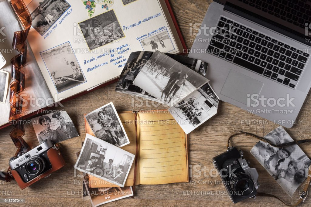 Old family photos on wooden background stock photo