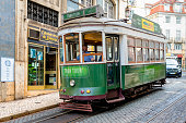 Lisbon, Portugal - October 17, 2019: Old famous tram in the street of Alfama, Lisbon