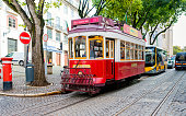 Lisbon, Portugal - October 17, 2019: Old famous tourist red tram in the street of Alfama, Lisbon