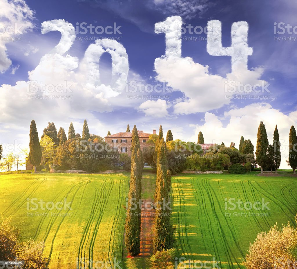 Old farm in field with skywriting 2014 royalty-free stock photo
