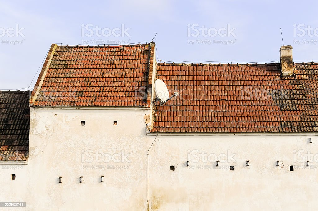 Old farm with modern satellite system stock photo