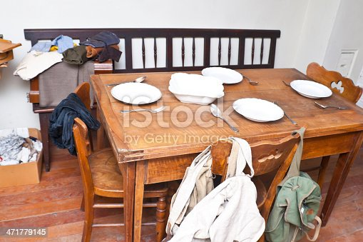 Traditional dining room with dishes of forestry workers in southern Tyrol