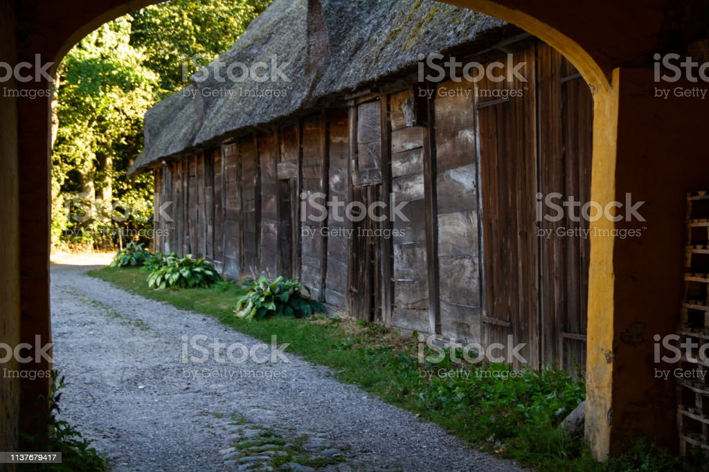 Old farming building and gateway stock photo