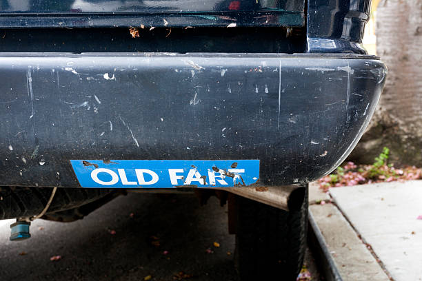 Old Fart OLD FART bumper sticker on even older fart of a car. Horizontal. coot stock pictures, royalty-free photos & images