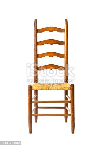A French style rustic farmhouse wicker Chair on white background