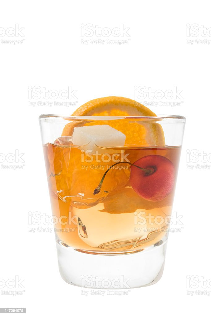 Old fashion cocktail with an orange and cherry garnish stock photo