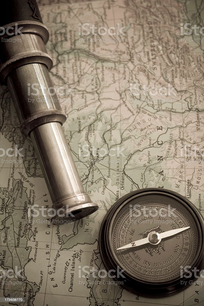 Old Fashion Compass and Telescope on Map royalty-free stock photo