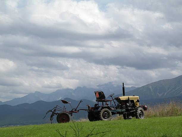 Old fashion harvest machine stock photo