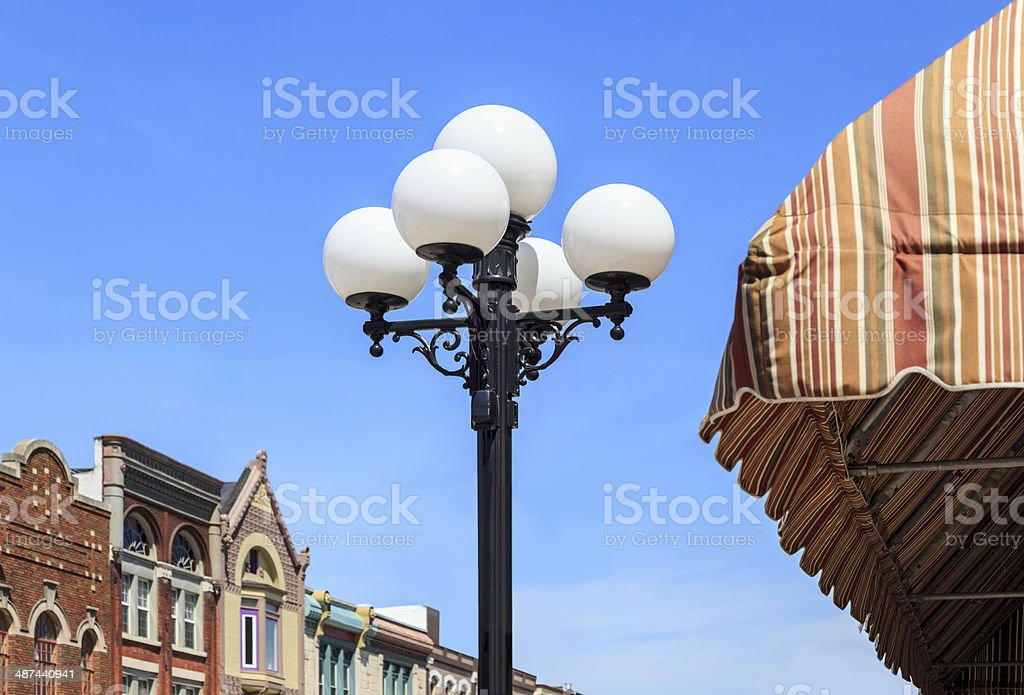 Old fashion light pole in downtown Bloomington, Illinois stock photo