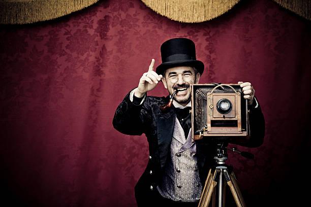 Old fashion Photographer taking photo stock photo