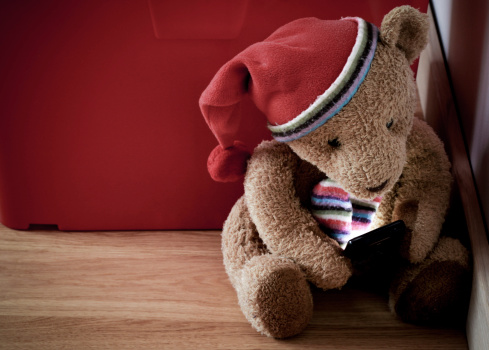 Old Fashion Teddy Checking On A Smartphone Stock Photo - Download Image Now