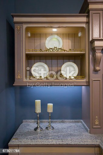 607472174 istock photo old fashioned artificially aged colonial style cupboard 673011764