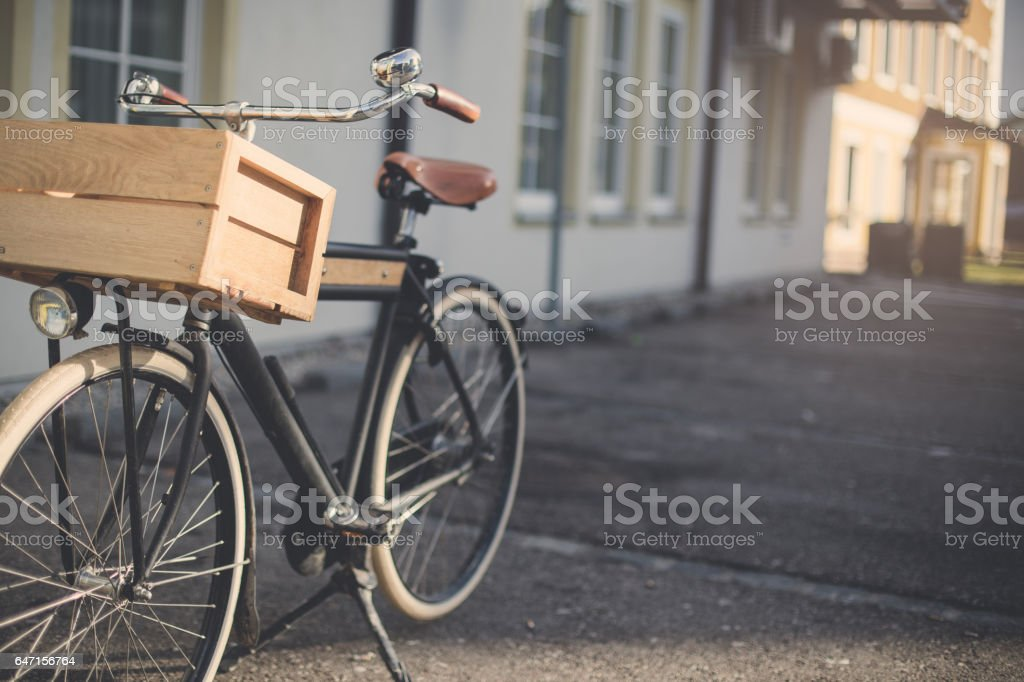 Old Fashioned Bicycle in small town stock photo