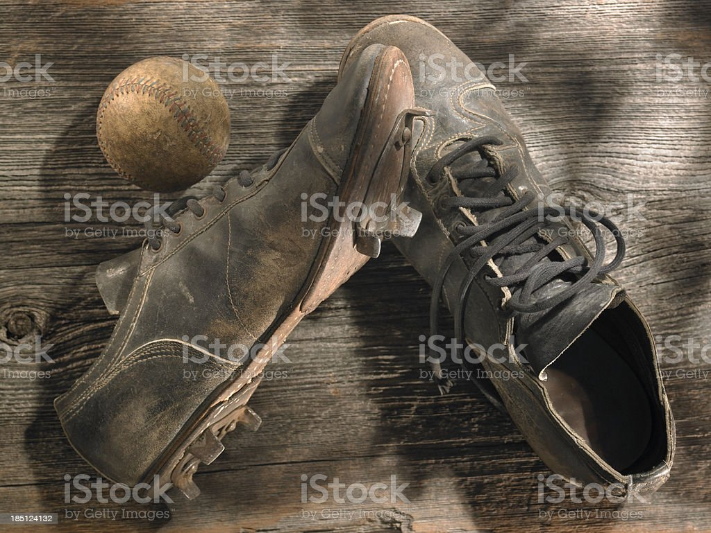 Old fashioned cleats with antique baseball stock photo