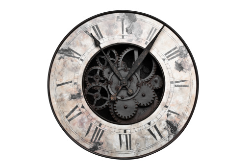 Old fashioned clock with visible center gears
