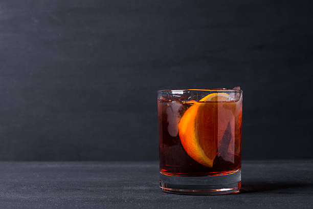 Old fashioned cocktail Old fashioned cocktail on the wooden background brandy stock pictures, royalty-free photos & images