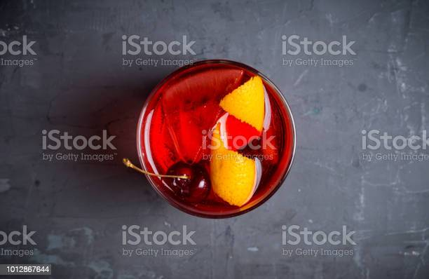 Old fashioned cocktail with cherry and orange peel picture id1012867644?b=1&k=6&m=1012867644&s=612x612&h=pd35mwbz mf9lozvio gcva1l5kwdorhhftjplf060m=