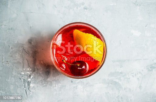 istock Old fashioned cocktail with cherry and orange peel 1012867780