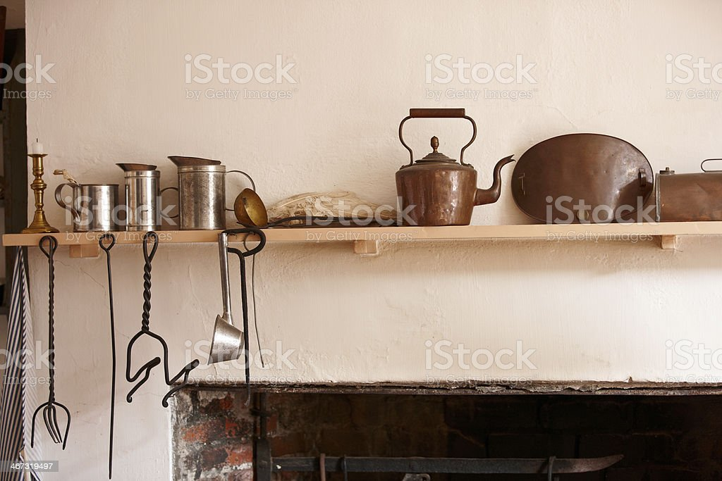 Old fashioned copper and tin cooking utensils royalty-free stock photo