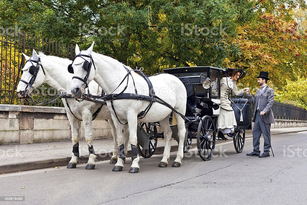 Old fashioned couple with vintagehorse Carriage stock photo